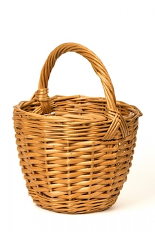 Old wicker basket on a white