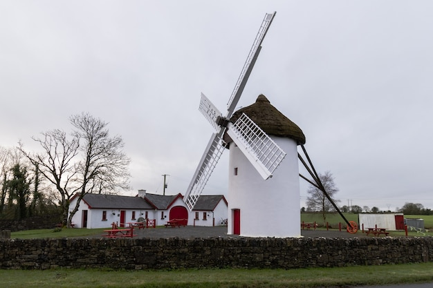 The old windmill at elphin in ireland with old outbuildings beside