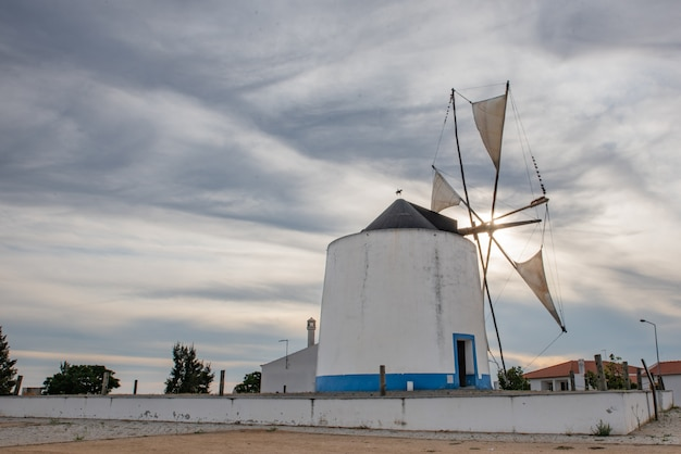 Old windmill with its moving blades