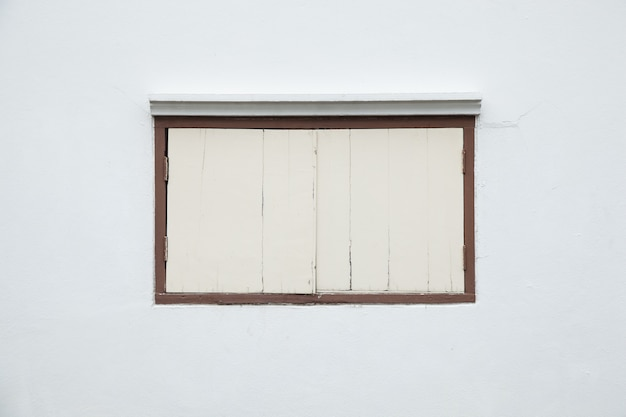 Old window on a white wall.