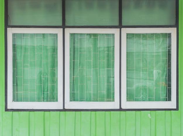 Old window on wood wall