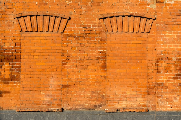 Old windows laid with red brick. texture