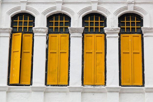 Old windows on white wall