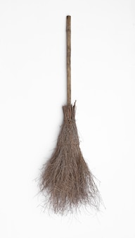 Old witchs broom isolated on white background