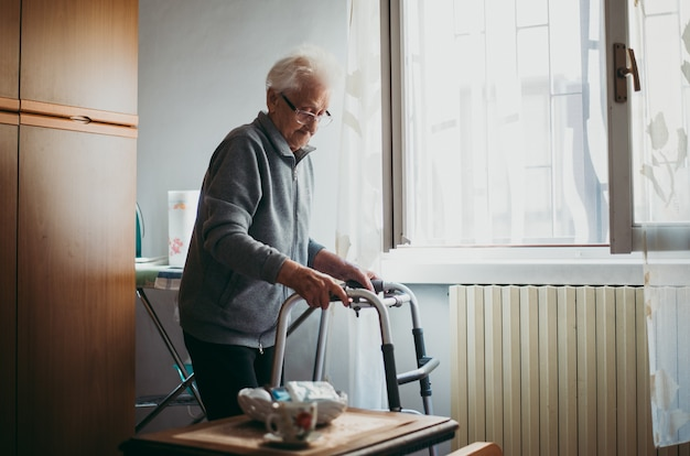 Old woman alone in her room. 95 years old grandmother thinking about her life and memories