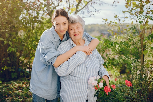 Old woman in a garden with young granddaughter