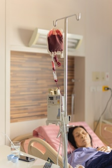 Old woman patients have blood transfusion in the hospital