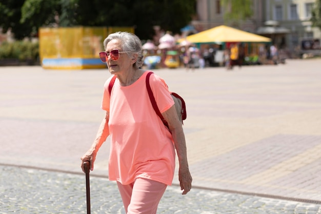 Old woman traveling alone in the summer