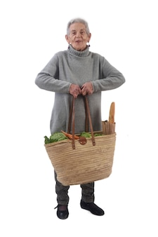 Old woman with a basket weighing a lot