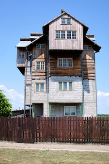 Old wood and brick house in a village in romania