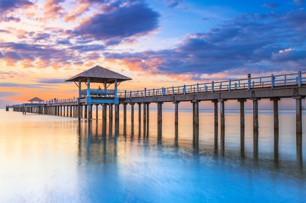 Old wood bridge pier  against beautiful sunset sky use for natural background