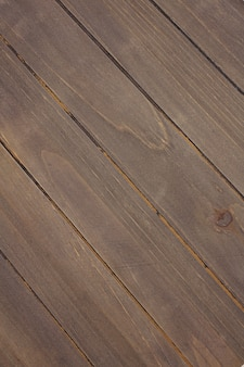 Old wood planks arranged diagonally texture background