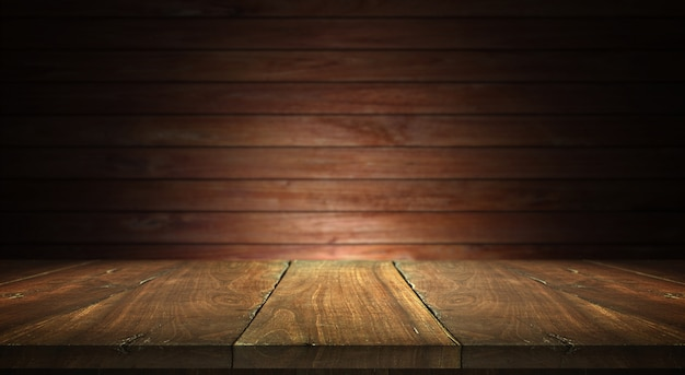 Old wood table on blurred wall background