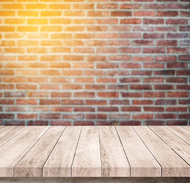 Old wood table with abstract old brick wall background