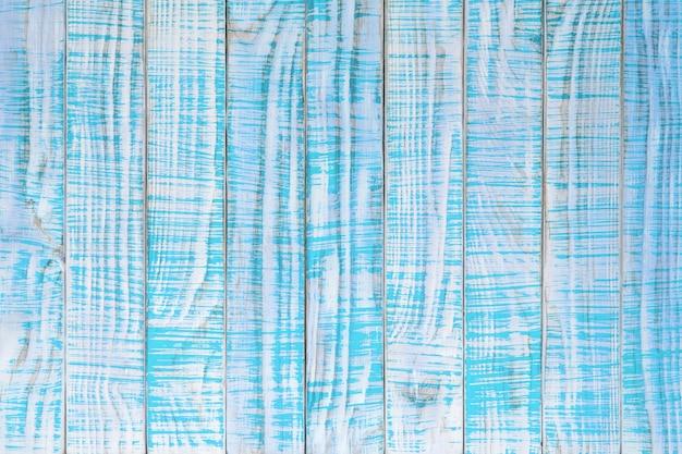 청록색 또는 청록색 색상으로 칠해진 오래된 나무 질감