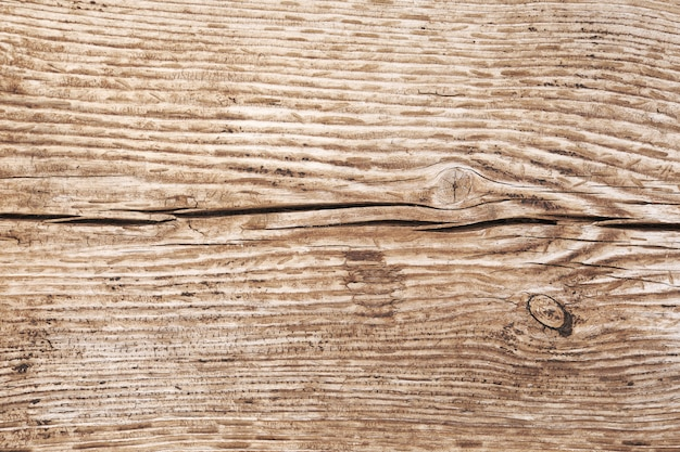 Old wood wall overhead close up shoot. grunge dark wooden wall with old rough timber. grey brown color. rustic style. close up photo from a building. focus all over the frame