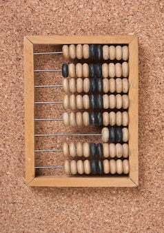 Old wooden abacus on a cork board