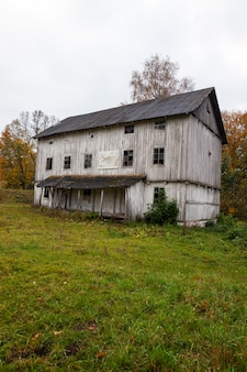 An old wooden abandoned mill white color. belarus