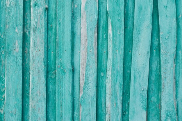 Old wooden background of boards with cracked and peeling paint