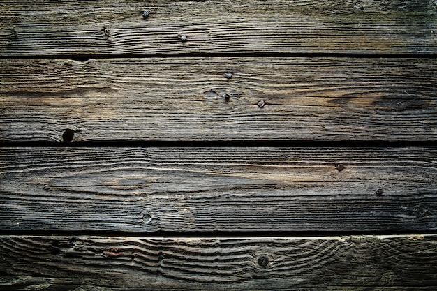 古い木製の背景。木製のテーブルまたは床。そして