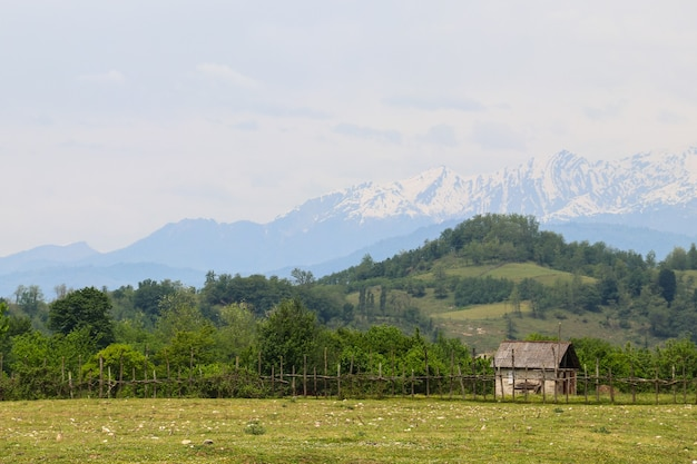 Old wooden barn in the village in caucasus mountains