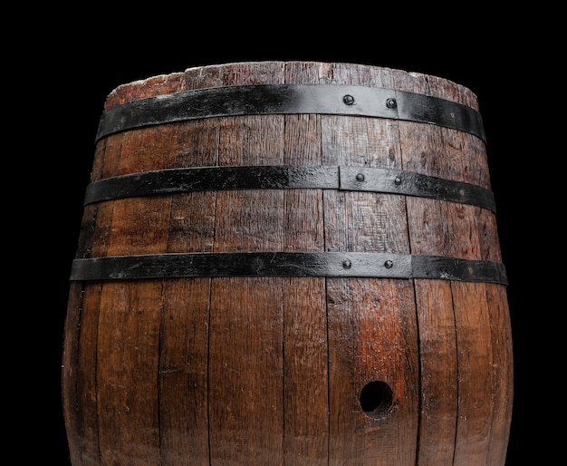 Old wooden barrel on a dark background