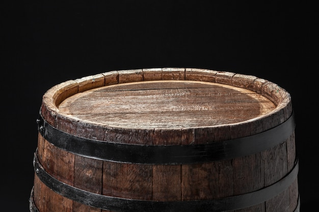 Old wooden barrel on dark