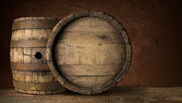 Old wooden beer barrel on the dark background