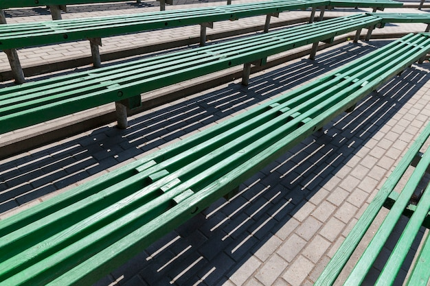 Old wooden benches of green color