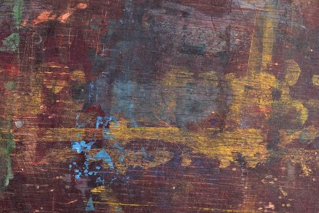 Старая деревянная доска с пятнами краски как фоновая текстура