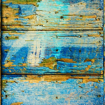 Old wooden boards with flaking blue paint, may be used as background