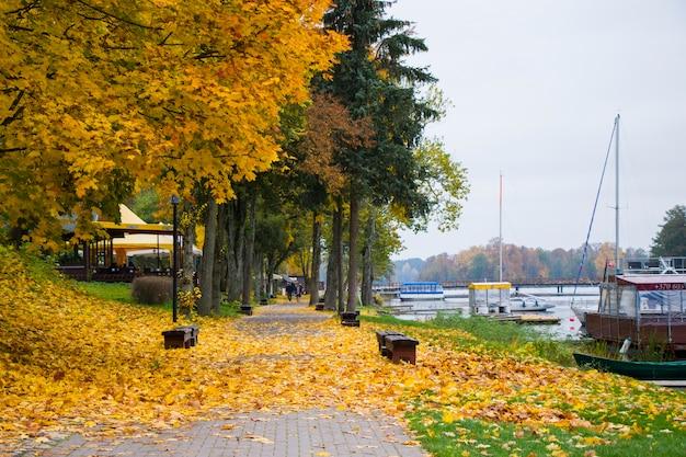 Old wooden boats near the beach of trakai gavle lake , lithuania. autumn and fall time.