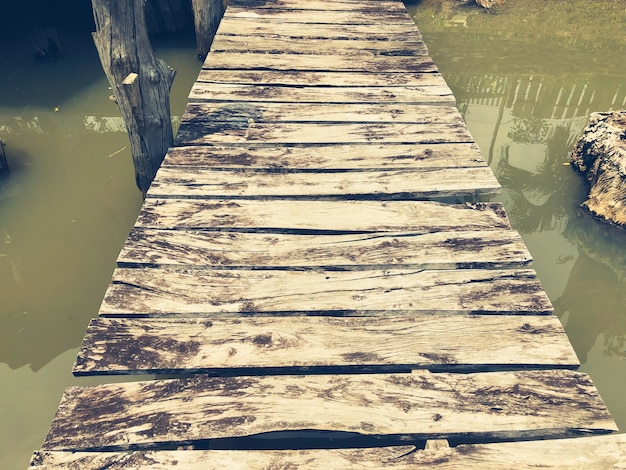 Old wooden bridge across the water.