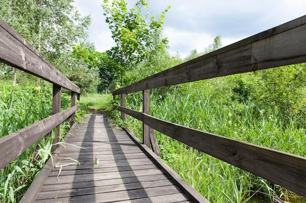 Old wooden bridge built on the lake
