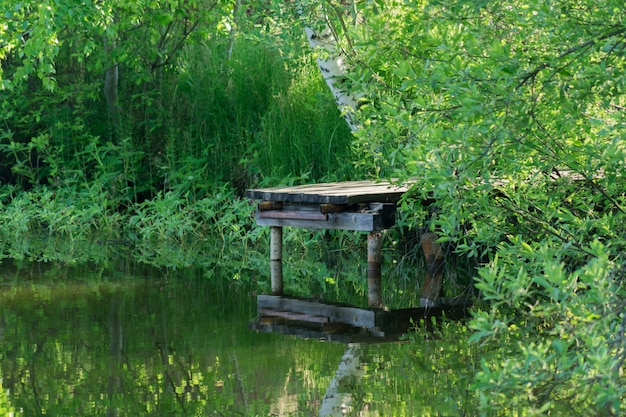 Old wooden bridge over the pond.