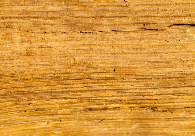Old wooden construction, on the surface of the wood there are traces of destruction from the external environment