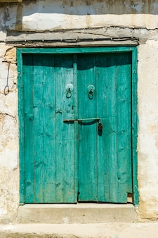 Old wooden door painted with white paint