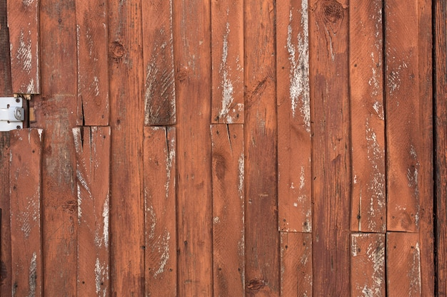 Old wooden door with peeling and cracked paint.