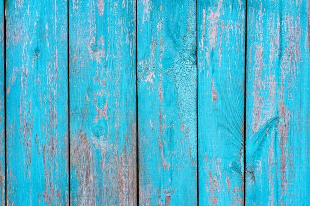 古い木製のフェンスの青いペンキの剥離ボードのテクスチャ。バックグラウンド。