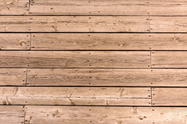 Old wooden floor of crooked boards background. natural wood texture.