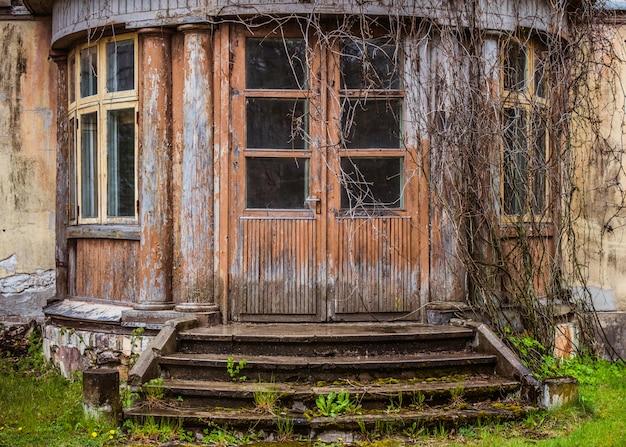 Old wooden grunge house door outside