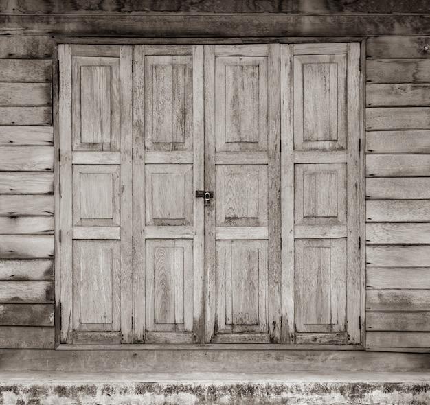 Old wooden house door with lock