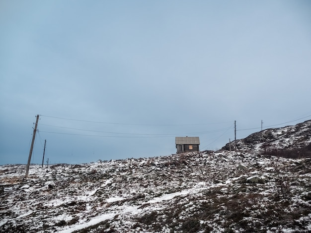 An old wooden hunting lodge on the polar hill