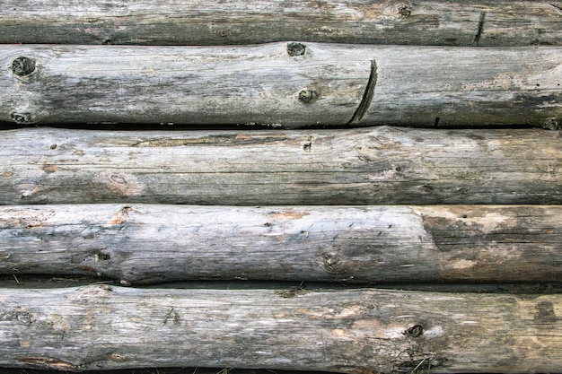 Old wooden logs with mold. natural aging of wood. not protected from the environment wood. dismantling of old wooden structures.