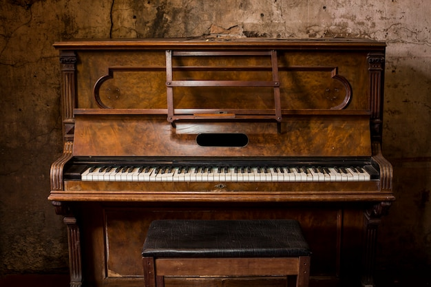 Old wooden piano keys on wooden musical instrument