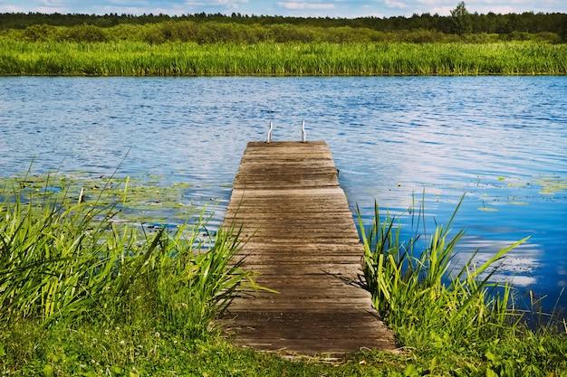 Old wooden pier in the river