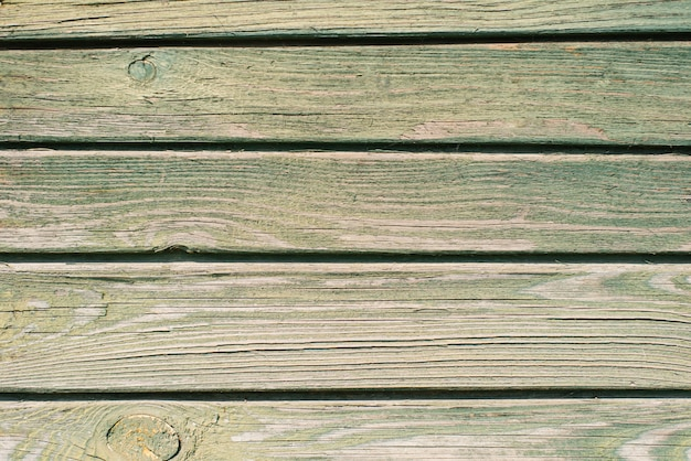 Old wooden plank background. peeling green paint on old boards. copy space