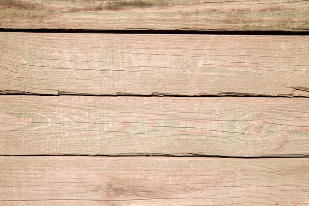 Old wooden planks.boards with cracked relief and paint residue.texture of old wood.