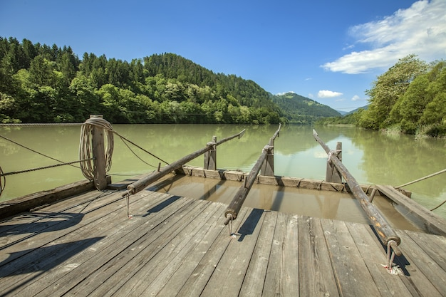 Old wooden raft on the drava river in slovenia