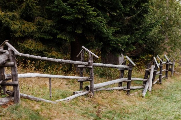 Old wooden rural fence in the mountains of a beautiful autumn day